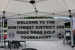 Northwest District 250 increases donation for Guide Dogs again!